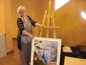 Isabel Suarez y su cuadro: dos obras de arte