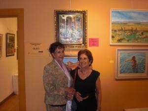C.H Y Maria Rubio delante dell cuadro premiado